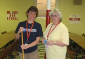 My mom (left) and my neighbor, Mrs. Lopresti, help clean up afterwards.