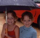 Andie (right) and Hunter ham it up on a rainy day.