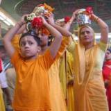 Carrying milk on their heads symbolizes the burdens Hindu believers carry to show their devotion to their gods.