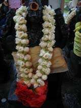 Hindu devotees offer large garlands of jasmine flowers to their gods.