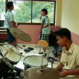 Pangjee and her friends practice at school.