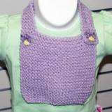A simple baby bib is a great first knitting project.