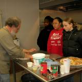 Chef Jim serves (left to right) Fannie, LaLee, and Carissa his home-made pizza.