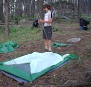 Mike sets up tent.