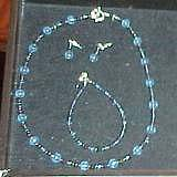 One of Emma's matched sets from blue glass beads: necklace, bracelet, and earrings.