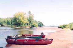 My friends pulled their canoes onto a sandbar during their Wisconsin River canoe trip last summer