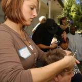 Volunteers give haircuts at the Day of Hope.